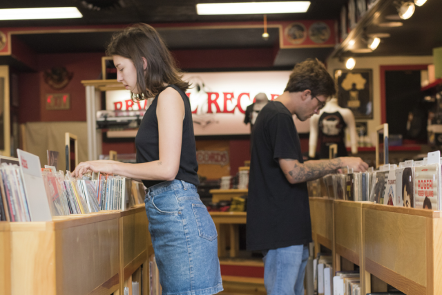 People looking through records at Revival Records in downtown Eau Claire
