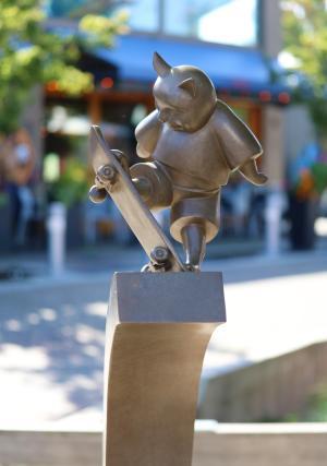 Sculpture of a cat skateboarding