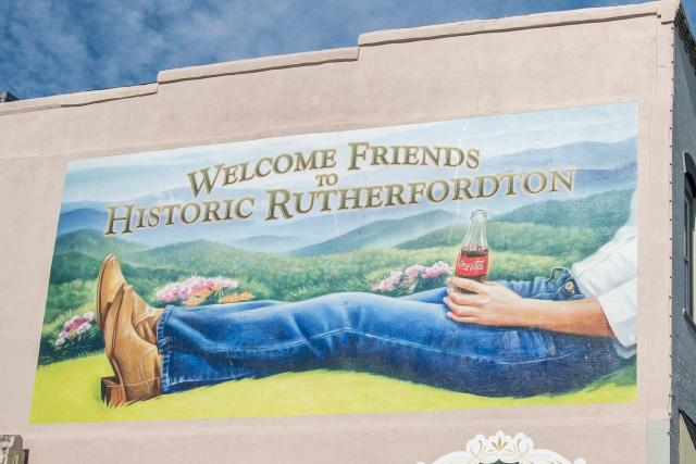 A Welcome to Rutherfordton mural features nostalgia with a Classic Coca-Cola bottle.