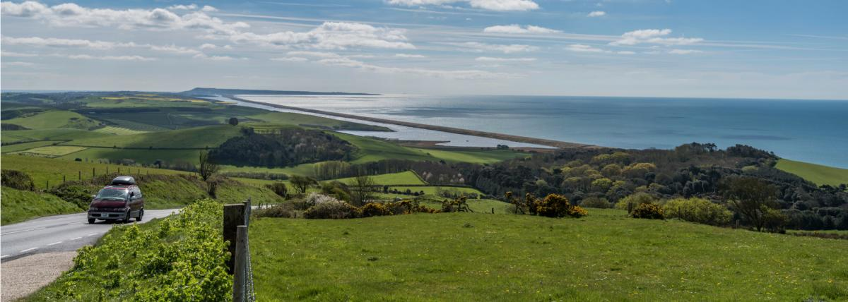 The coast road at Abbotsbury with views of Chesil Beach and the Fleet Lagoon