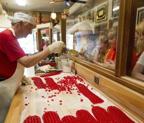 Candy maker working on red candy at Schimpff's
