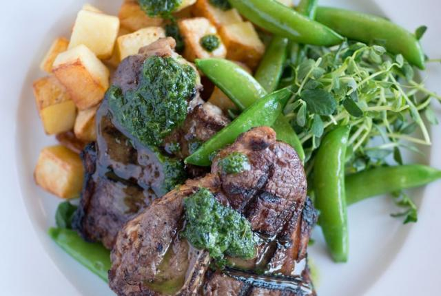 Lamb T-Bone with Roasted Yukon Potatoes, Snap peas, and Herbed Garlic Pesto