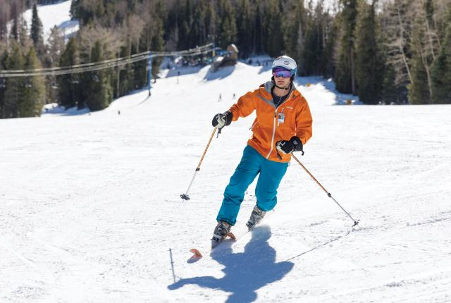 Skier on the beginner's hill at Pajarito Mountain Ski Area