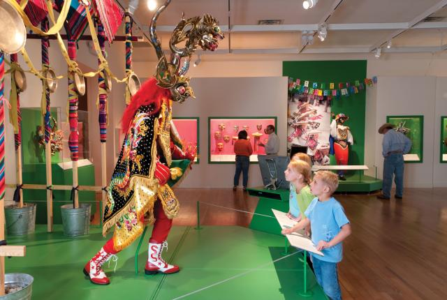 Ceremonial masks and larger-than-life costumes at the Museum of International Folk Art