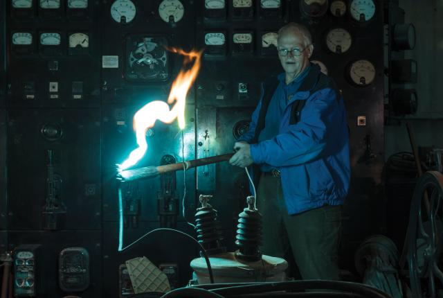 Tommy Bolack sparks a transformer in his electromechanical museum.