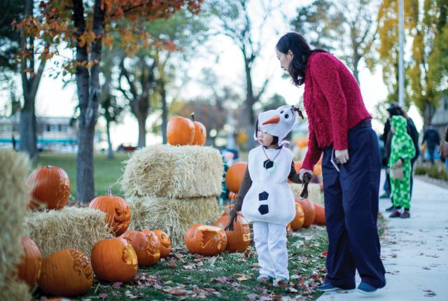 Little girl, dressed as Olaf from Frozen, and her grandmother at Los Alamos Halloween