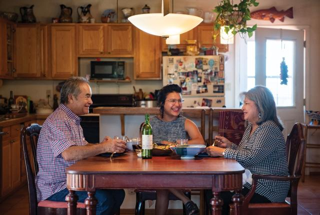 Richard, Alicia, and Dolores Guzmán dig in.