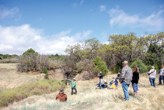 David Eck gestures toward the arroyo where history was discovered.