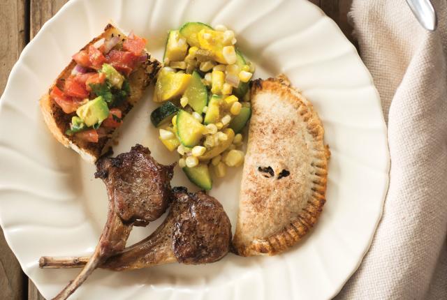 Empanadas cap a meal of lamb chops, beans, calabacitas, and pico de gallo