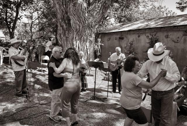Visitors dance at the Chimayó Museum's fiesta.