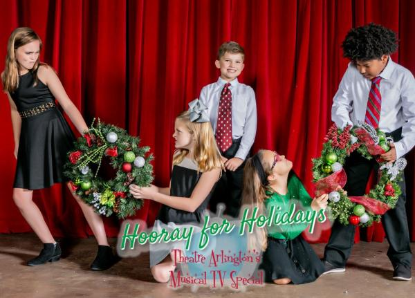 Photo of children with Christmas wreaths from Theatre Arlington holiday performance