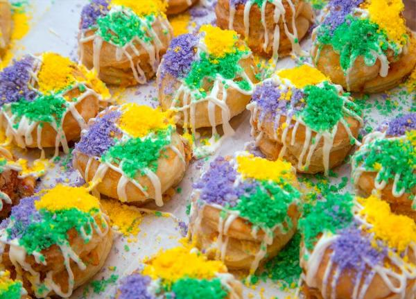 Mini-Crawfish King Cakes at Bosco's Italian Café are decorated in traditional Mardi Gras colors.