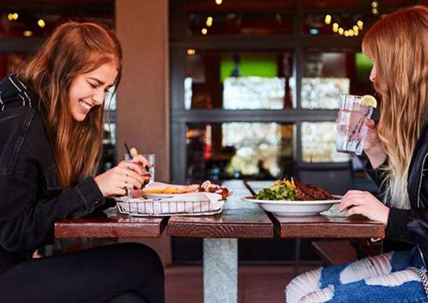 girls eating on patio at Rock n Brews