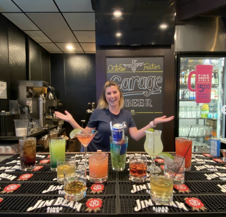 bartender and multiple cocktails at lucky duck pub in burlington ky