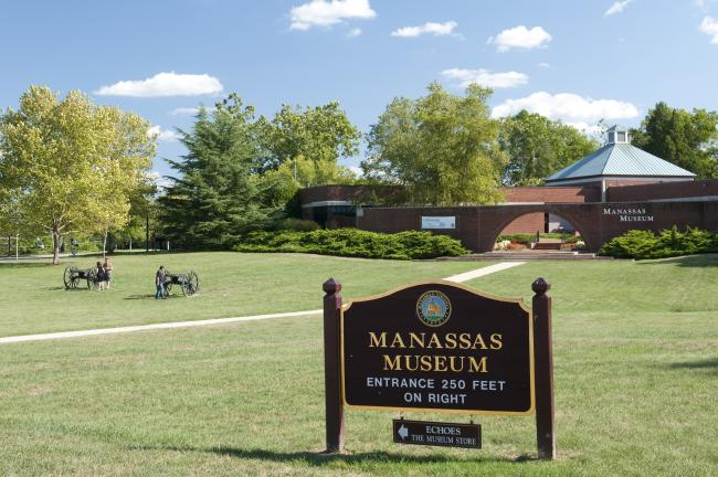exterior of Manassas Museum building with cannons and signage in front
