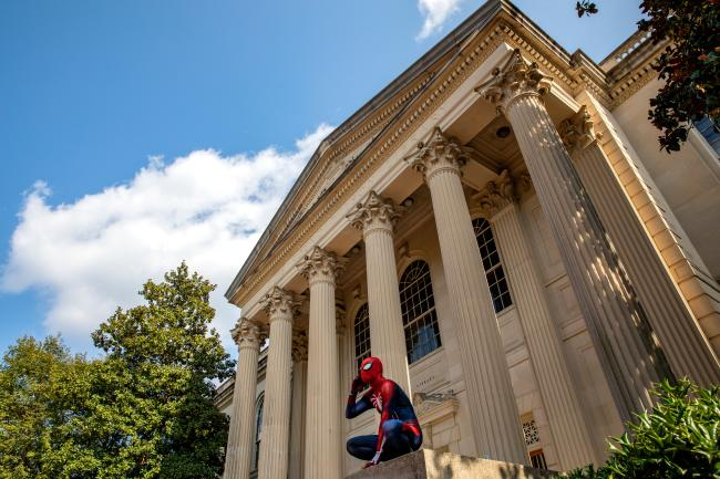 Spiderman perched on marker at Wilson Library UNC Chapel Hill