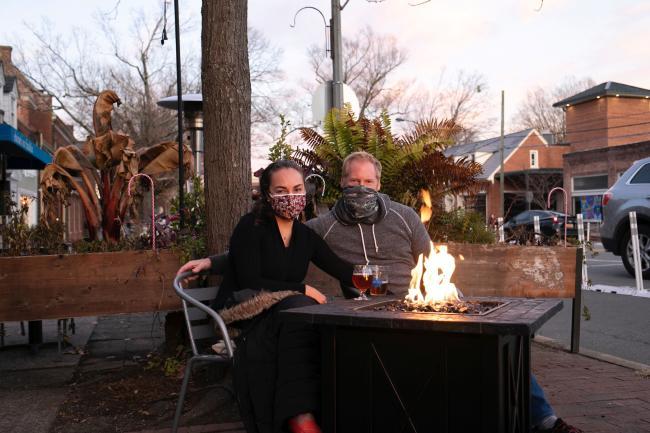 Patrons with masks dining outside at Carolina Brewery