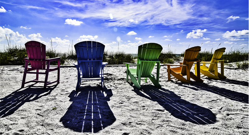 Adirondak Chairs in the sand - 800 by 433 px