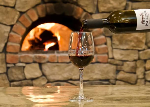 wine poured in front of oven