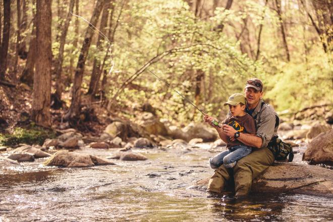 Father and son fishing in a creek in Botetourt County
