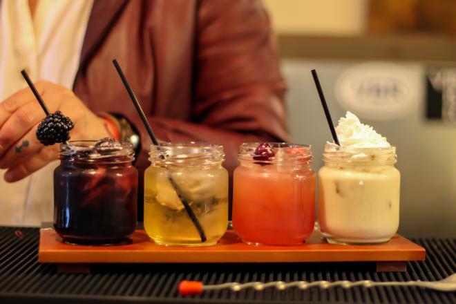Flight of 4 different moonshine cocktails.