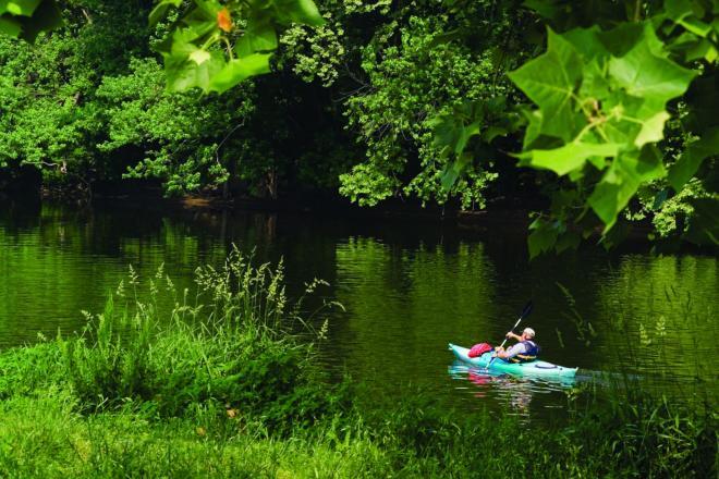 A kayaker moving along James River near Roanoke, Virginia