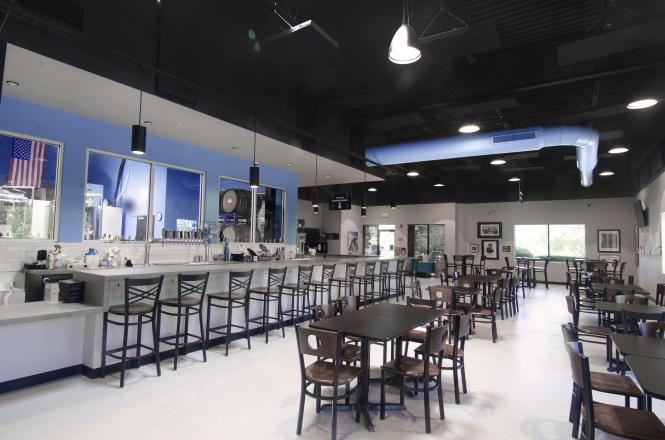 interior view of bar and tables at Pherm Brewing