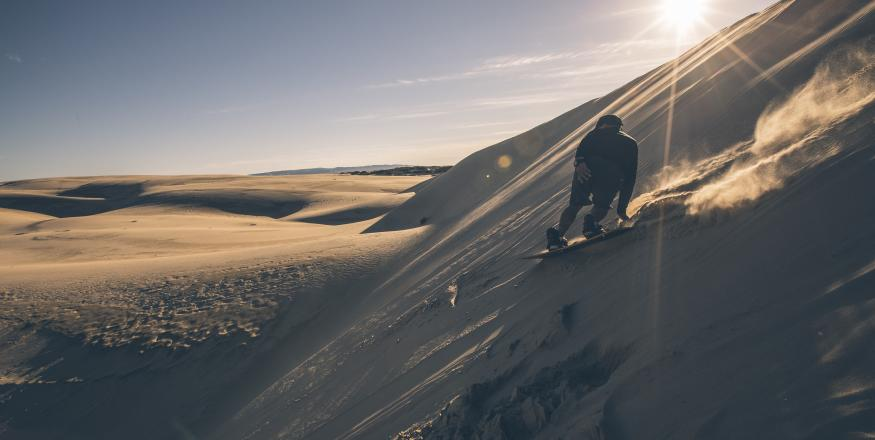 A Sandboarder, boarding down the Oceano Dunes