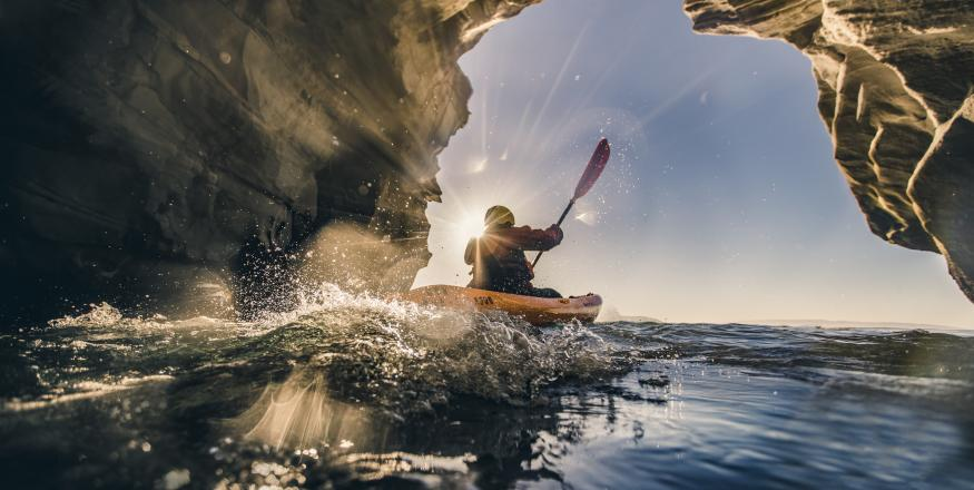 Kayaker In Dinosaur Caves