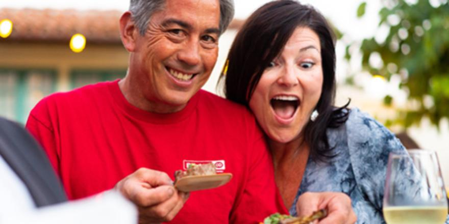 Couple with food at the Catalina Wine Mixer