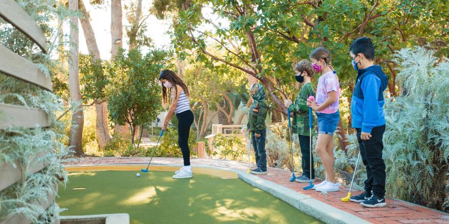 Kids playing mini golf at Catalina Island Mini Golf Gardens