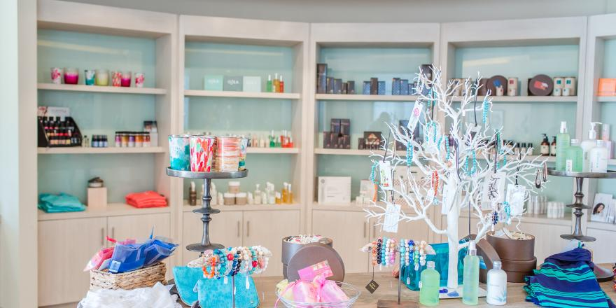 Retail shelving and table with products in Island Spa Catalina
