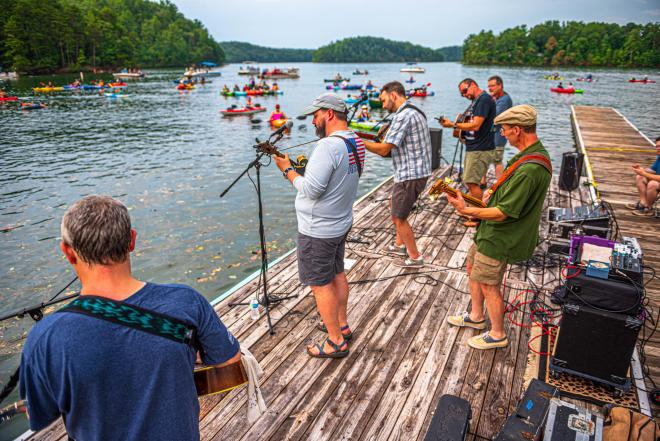 A band playing music at the Concerts by Canoe series in Philpott Lake, Franklin County, Virginia