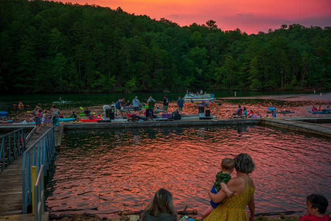 People on the dock at Philpott Lake enjoying Franklin County's Concerts by Canoe Series.