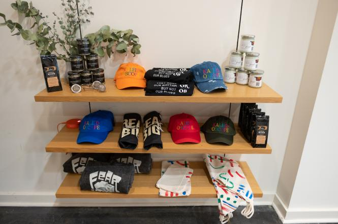 Kaleidoscope merchandise: hats, shirts, candles, etc.  for sale at the exhibit