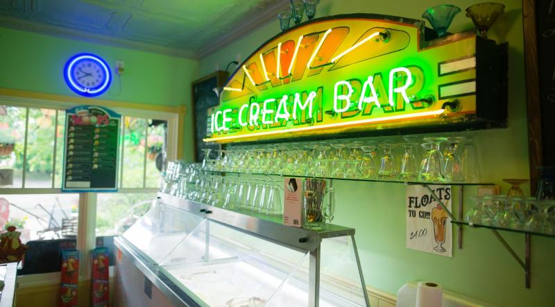 Neon sign saying ICE CREAM BAR inside Crow's General Store in Brandon