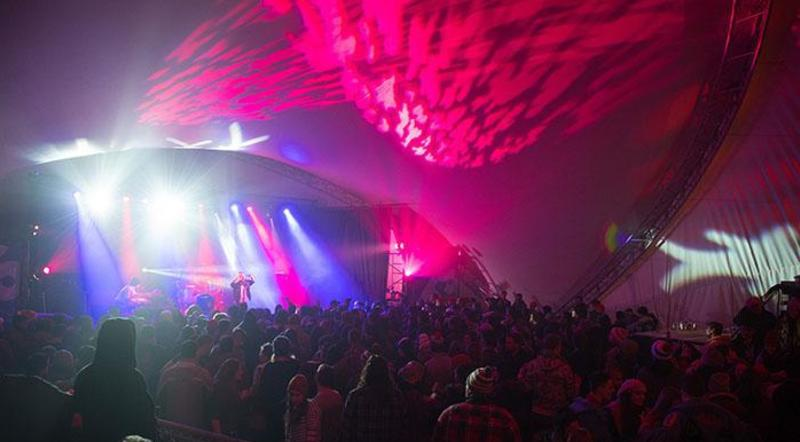 Crowd in a music tent at Festival du Voyageur