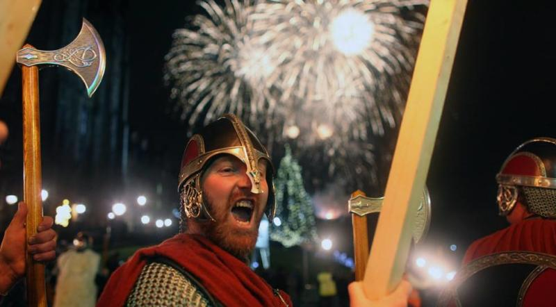 Man dressed as a Viking Warrior during the fireworks at Islendingadagurinn