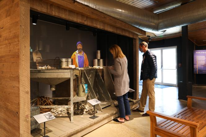 Guests interact with the holographic Waterman exhibit at the Annapolis Maritime Museum.