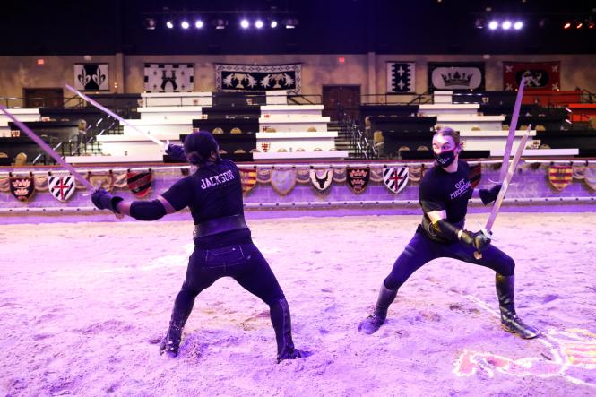 two knights practice for their performance at Medieval Times