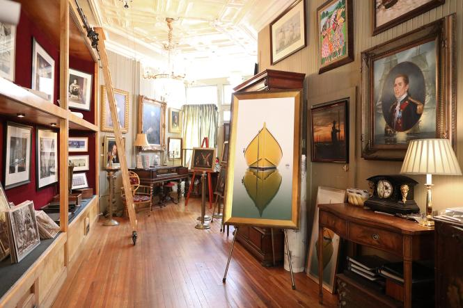 interior view of the gallery paintings and photographs as you walk through the front door