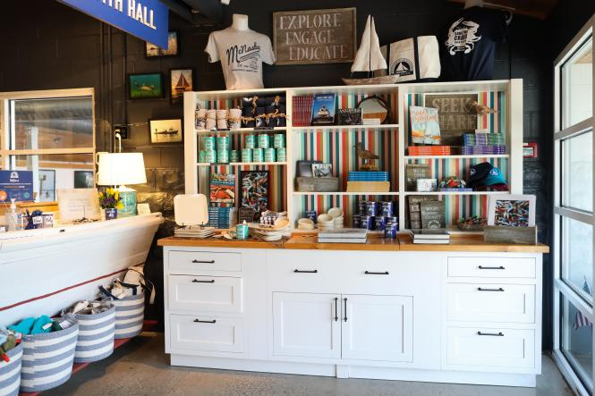 The gift shop at the Annapolis Maritime Museum with shelves of merchandise