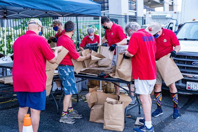 Volunteers package up crabs to go