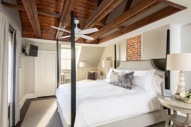 The Presidential Suite at 134 Prince has exposed beams in the ceiling