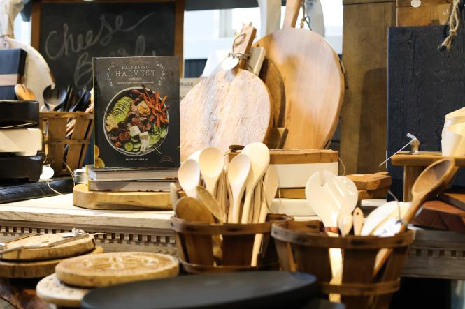 An array of wooden spoons and carving boards.