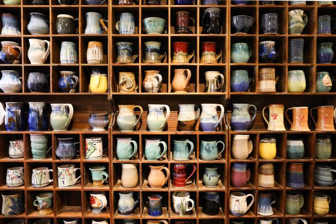 The mug wall in Annapolis Pottery.