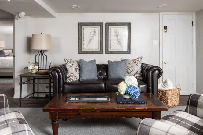 A leather couch and pillows awaits you in the two bedroom family suite