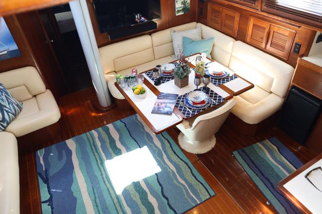 the galley and seating area of Seas the Bay