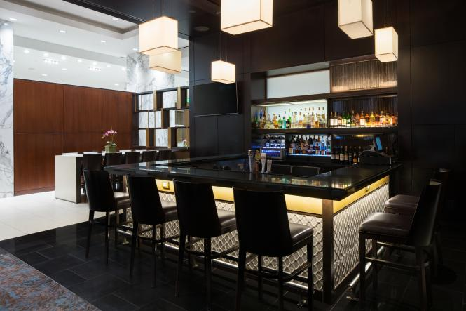 The Luminous Lounge at the Westin BWI, black stools and modern lighting