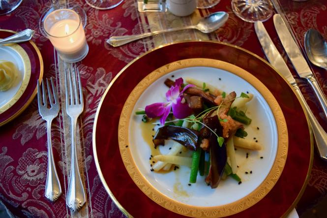 a dinner plate and table setting at Wine & Dine in the Garden